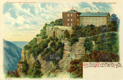 The witches dancing place on Broken Mountain. German postcard showing the Hexentanzplatz. Held to light it shows one scene....